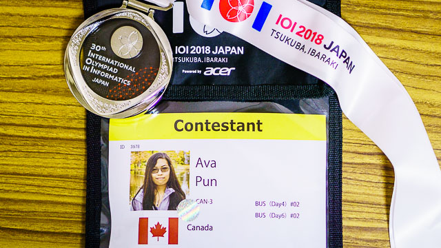 Ava Pun IOI contestant badge and silver medal